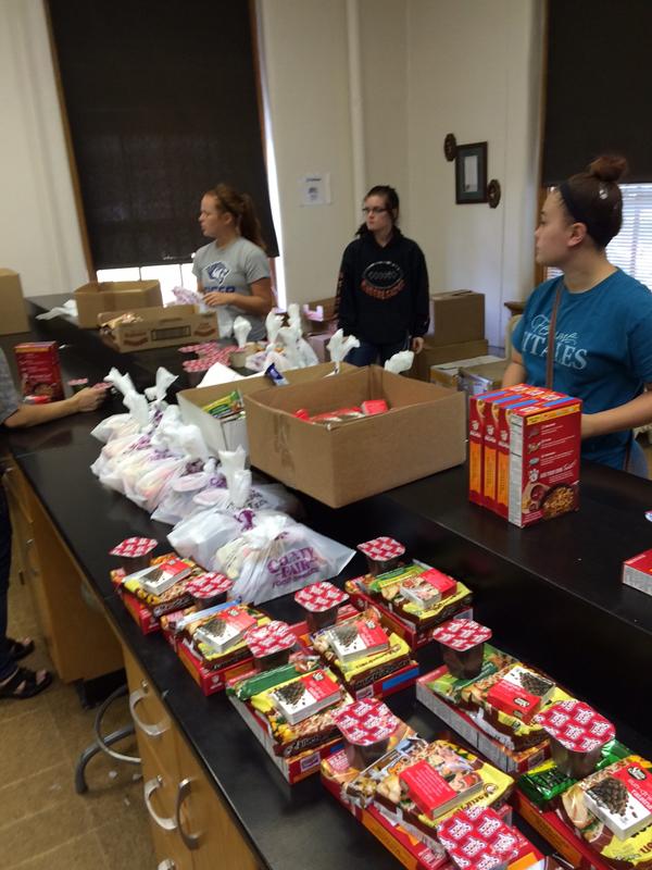 Students volunteering with the Weekend Snack Pack Program.
