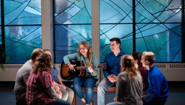 Students worshiping at night