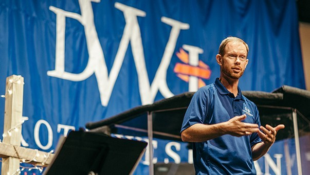 Campus pastor Eric Van Meter speaking at weekly services.