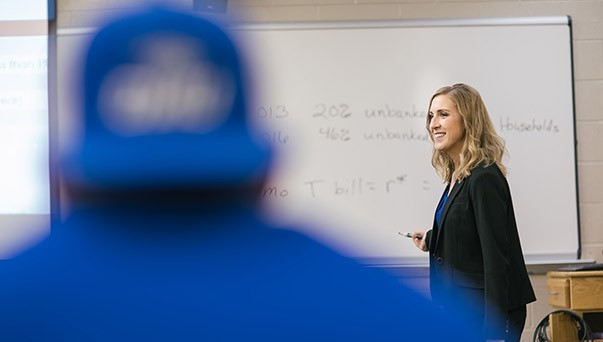 A female professor teaching a business class.