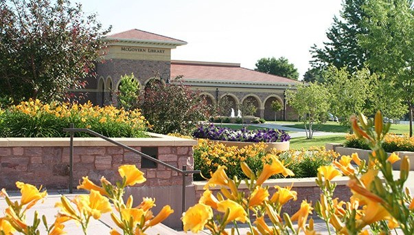 Photo of the McGovern Library with lilies in the foreground