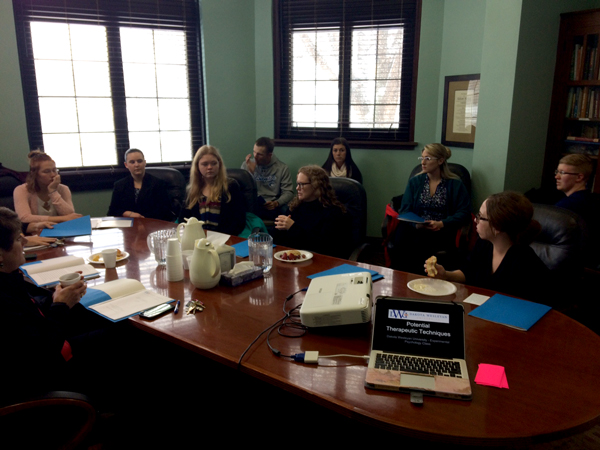 Psychology students present research to the Abbott House staff.