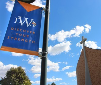 DWU campus with Sherman Center and Discover Your Strength banner