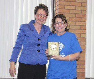 President Amy Novak gives Deb Ellis the Presidential Award for Outstanding Service.