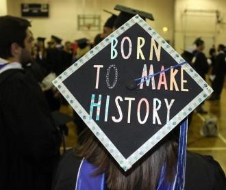 Graduation cap that reads: Born to make history