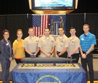 Photo of Amy Novak, Alyson Palmer, members of SS South Dakota, and Kyle Herges