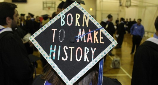 Graduation cap that reads: Born to make history