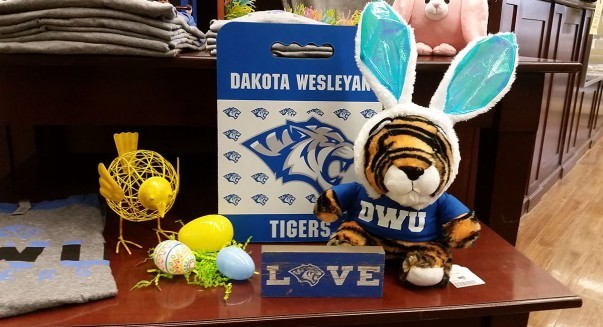 Easter image with stuffed tiger and Easter decorations.