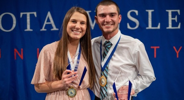 Students smiling with awards